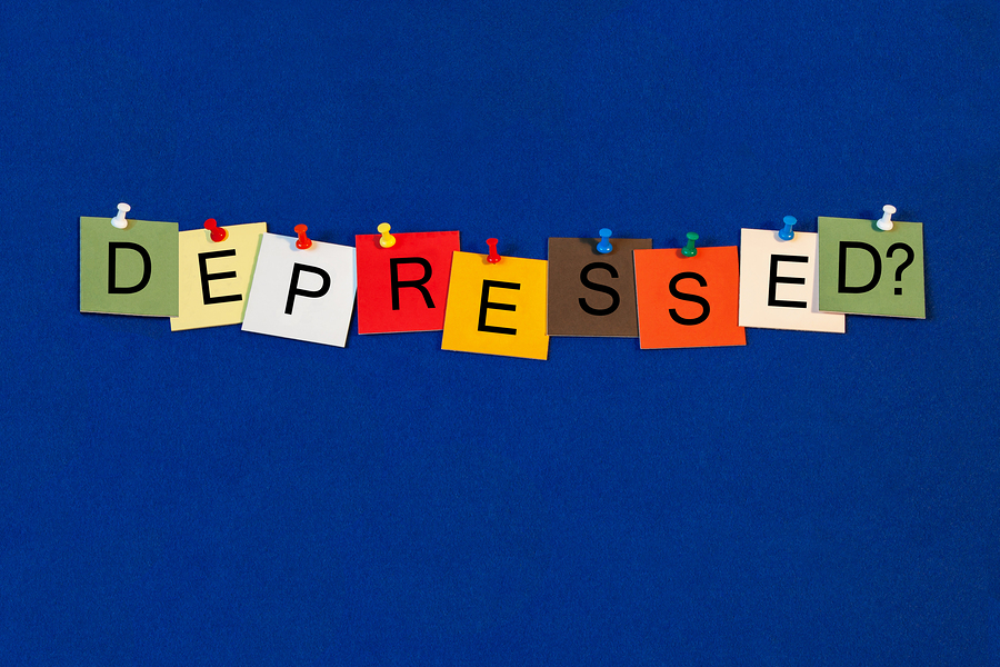 Depressed ..? Sign for health, on noticeboard with pins.